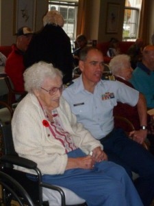 Marjorie receives her Coast Guard pin from a visiting American Legion Coast Guard Veteran
